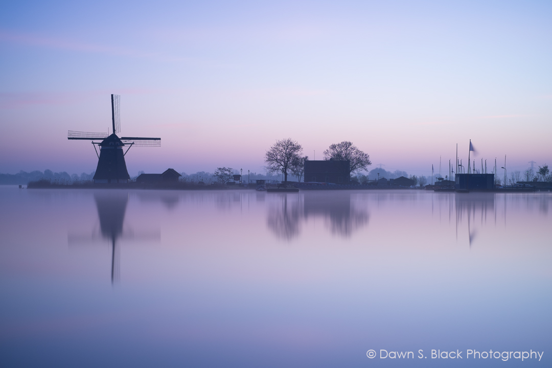 Getting up pre-dawn does not come naturally to be, despite my name! Sometimes though the effort is made worthwhile. I've been to this location many times and being a lover of windmills have photographed it a lot. This made it easy to know where to stand and how I wanted the comosition to look. This morning proved to be magical as the light before the sun came up took on this purple hue. A long exposure of more than 3 minutes to smooth out the water and gente morning mist helped to create the calm and serene atmosphere I wanted.   Fuji X-T1, 35mm, Lee Big Stopper ISO 200, 200 secs, f/5,6